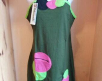 Dress has asymmetrical khaki suspenders