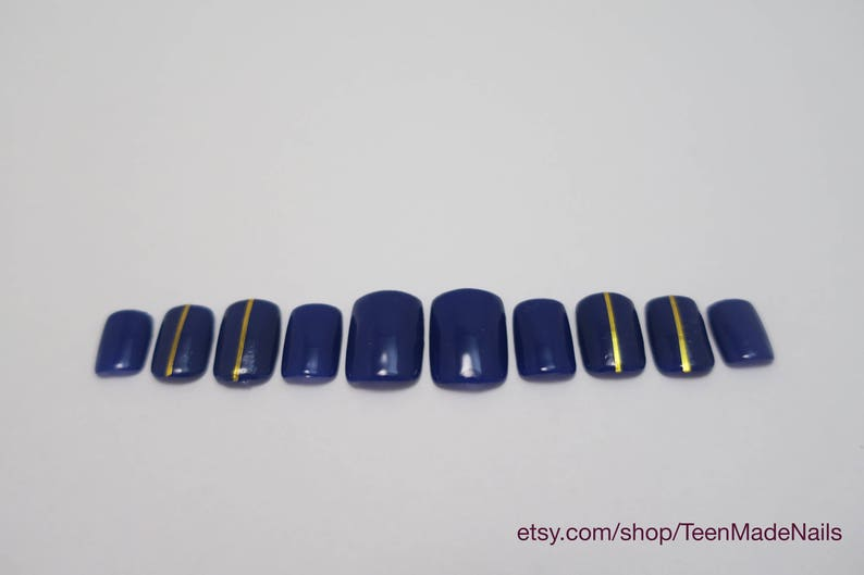 Navy Short Press On Nails With A Gold Stripe Set Of 10