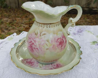 Whimsical mint green and pink floral pitcher with basin