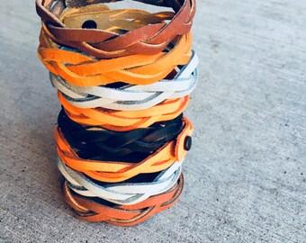 Braided leather snap bracelets