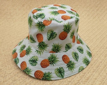 Pineapple and monstera baby bucket hat