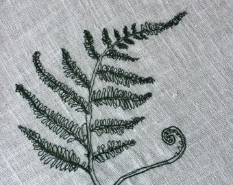 Machine embroidered fern leaf