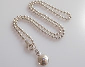 Vintage Danish Hermann Sierbsol silver and zirconia disc pendant on a silver bead chain necklace