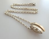 Danish Hans Henrik Nygaard textured silver pendant with gold and zirconia detail