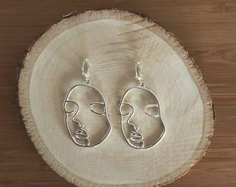 2 face earrings