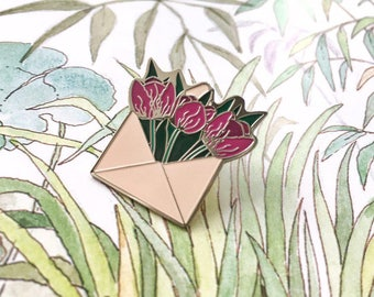 Hard enamel pin in form of envelope filled with purple tulips