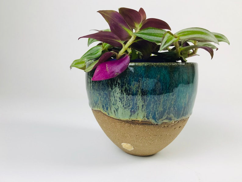 Unique stoneware vase with shades of blue and green.