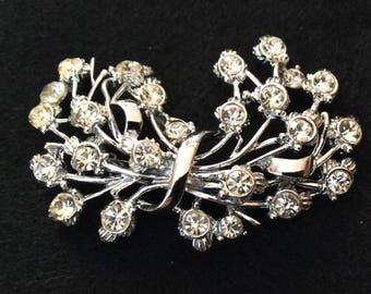 Rhinestone and silver brooch