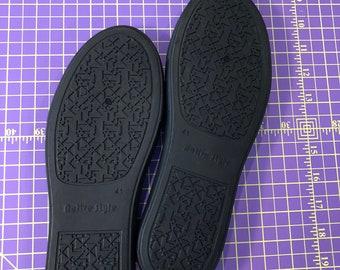Black rubber cupsoles, shoe soles, sneaker soles