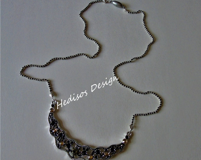 Noble necklace in silver and black with silver # connector and # magnetic clasp # 65 cm