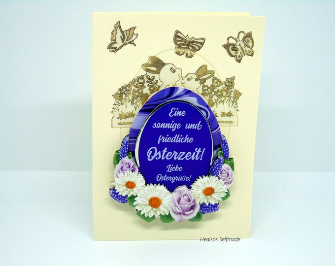 Easter card # 3-D look #Easter egg with saying, #Easter bunnies, #Margarites, #Roses. #Butterflies
