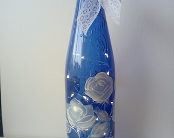 Hand painted blue wine bottle filled with LED fairy lights