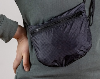 Sustainable Recycled Travel Purse for Bike rides and City Errands. Cross body bag and waist bag. Made in Berlin.