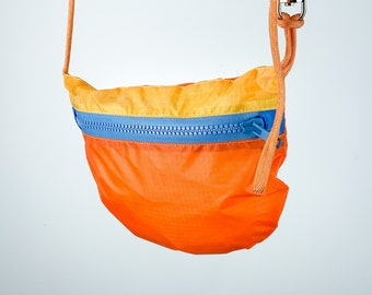 Sustainable Recycled cross body Purse for Bike rides and City Errands. light weight and packable. Made in Berlin