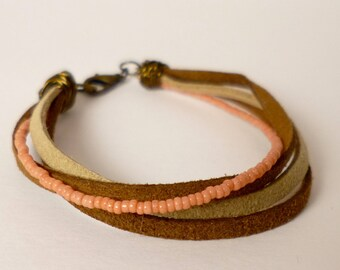 faux suede, glass seed bead, and brass bracelet