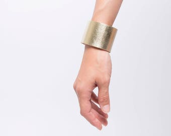 Leather cuff with magnetic clasp