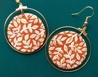 2 drop length Polymer clay rust colored earrings Stamped pattern on front sterling silver ear wiires.