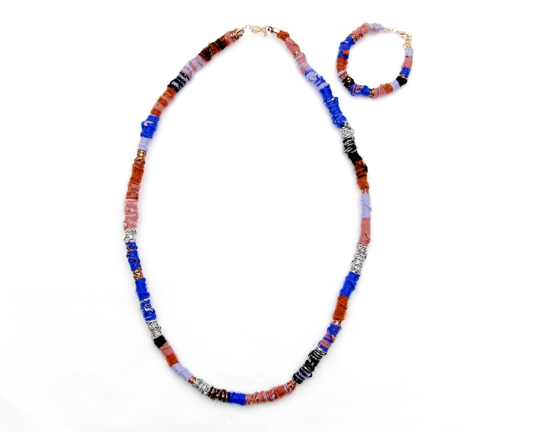 Adjustable lengths acrylic wool and cotton are braided and knotted Set Necklace and bracalet Gold-colored closures. Wool