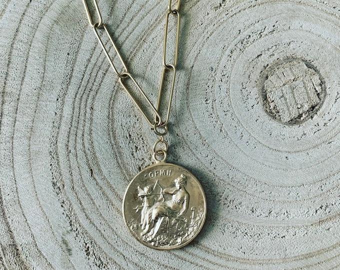 """""""Cupid"""" necklaces"""