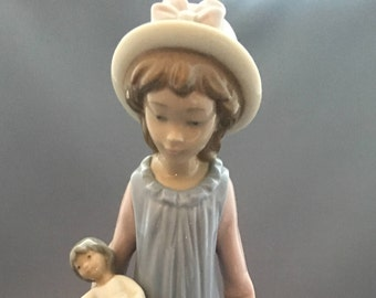 Lladro Belinda With Her Doll Figurine.