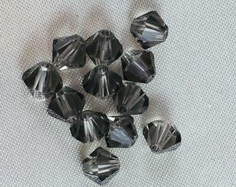 Swarovski Vintage 5mm Black Diamond (non-AB finish) Bicone Beads.  12 BEADS per order.