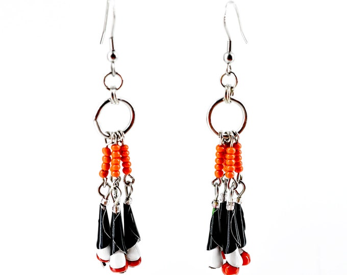 Chandelier-style earrings, high-end jewelry in soda cans, red and black earrings