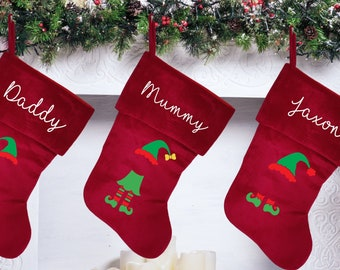 Personalised Christmas stocking with family elf design, traditional red Christmas stocking