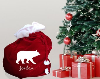 Personalised XL Christmas sack with polar bear design, traditional red present sack