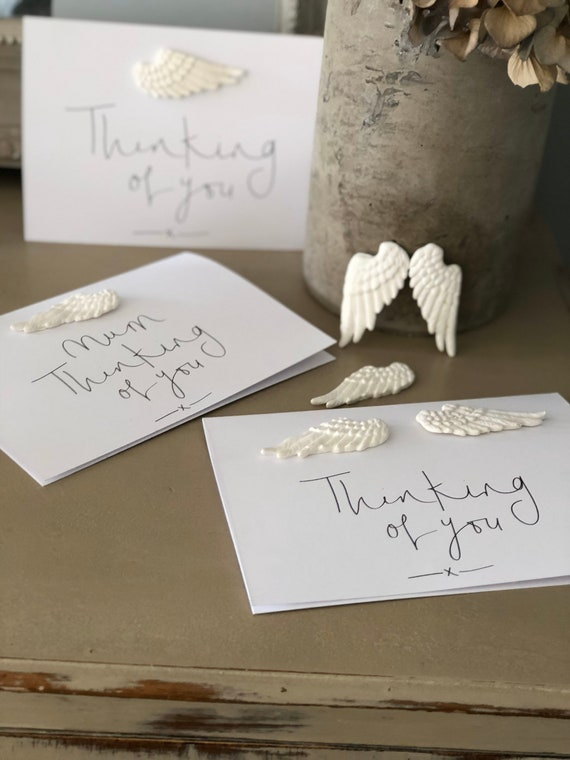 Handmade clay feather keepsakes