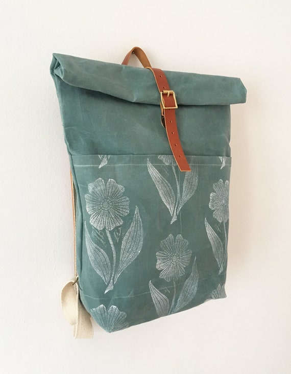 Blue green waxed canvas roll top backpack with hand block printed pattern roll top waxed canvas rucksack