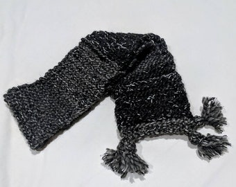 Chunky knit black and grey striped scarf with white speckles.