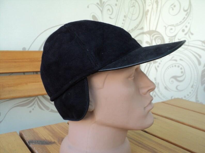 a winter cap a youth cap a men/'s baseball cap artificial leather a black cap, fur a warm hat A classic baseball cap a visor