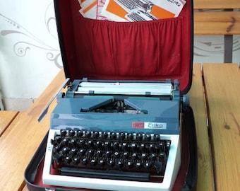 1980, white, manual typewriter by Erika, FAB carrying case, Good condition. GDR.