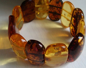 cognac cabochons Matt cabochons The bracelet is multicolored from natural Baltic amber Made of hard amber plates. white cabochons