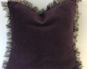 luxurious handmade velvet cushion with guinea fowl feather trim