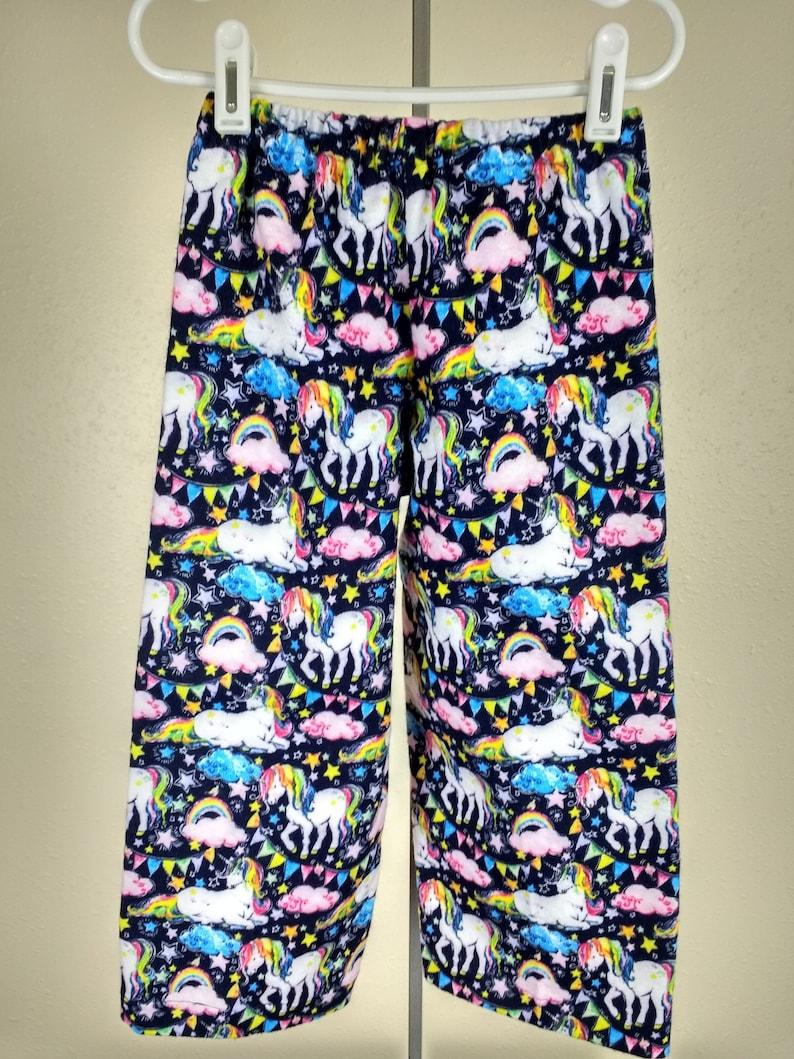 86709b2a8 Pajama pants rainbow unicorn print flannel children | Etsy