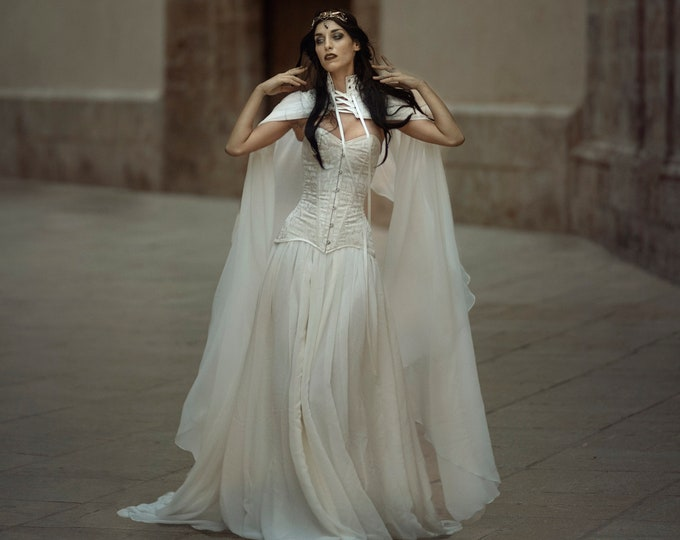 Medieval white witch bridal dress with cape for ceremony amidst the trees, Viking goddess gown for enchanted woodland wedding, Corset dress