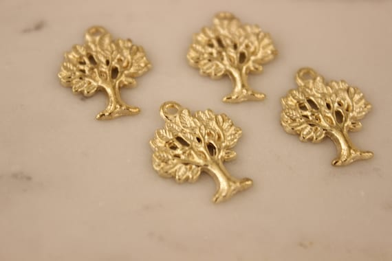 4 Tree charms gold tone GC210