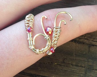 Wire-wrapped ring with red bead accents