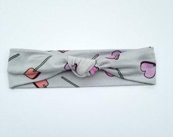 Light gray heart and lollipop top knot headband