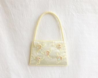 Vintage beaded handbag purse with flower design.
