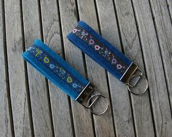 Key fob birds either blue or dark blue