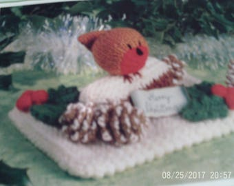 Handmade Knitted Little Robin Redbreast Sitting On A Log With Holly And Pine Cones On A Pocket Base (New, Made To Order)