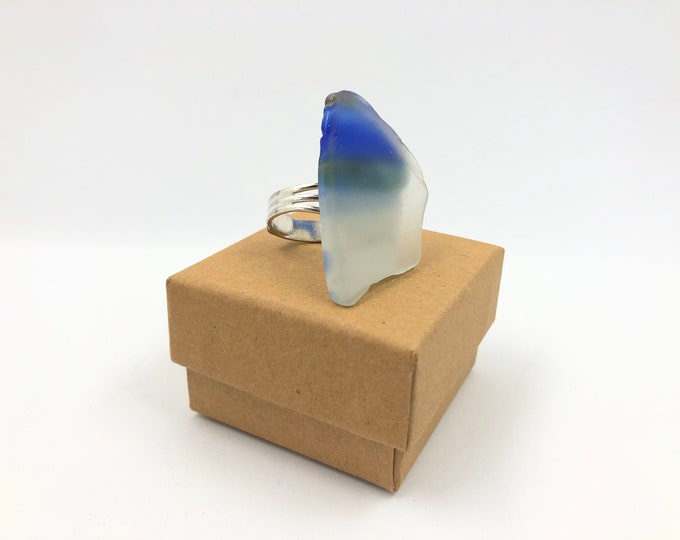 Fashion dress ring. Handmade from an original 70's fused glass 'fish'. Silver plated adjustable ring. Fun. Funky and helps save the planet!