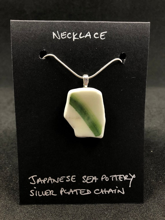 Japanese Sea Pottery Pendant with necklace. Each item is handmade & totally unique. The perfect gift for someone special.