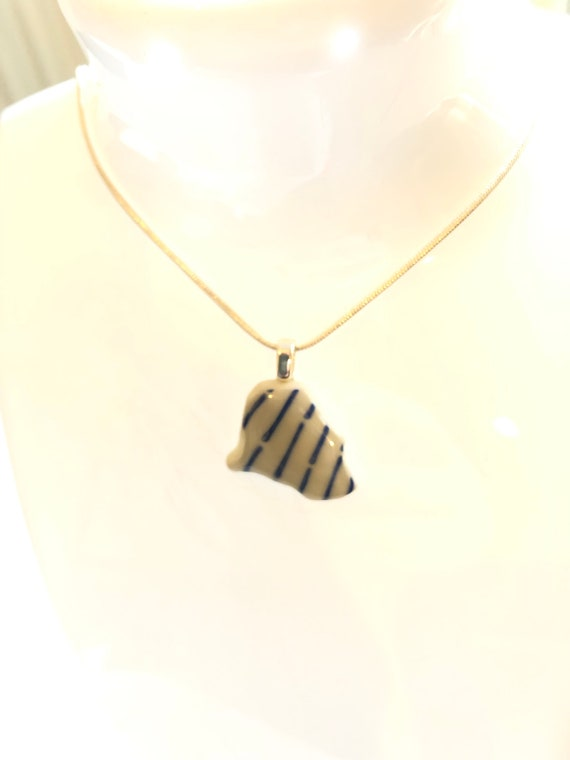 Japanese Sea Pottery Pendant with choice of necklaces. Each item is handmade & totally unique. The perfect gift for someone special.