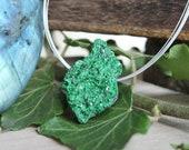 Fine crystals of green garnet (says ouvarovite) pendant