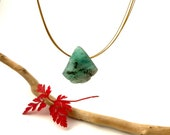 emerald with pendant inclusions