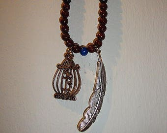 Chain with bird cage and feather ~ opt for safety or freedom