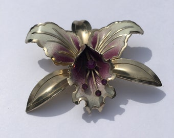 Vintage enamelled orchid brooch with purple crystals